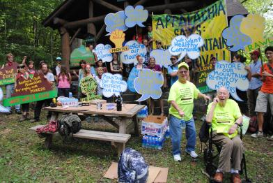 People with signs at Kanawah State Forest, Mountain Mobilization