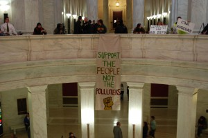 Banner Reading &quot;Support the people, not the polluters&quot; in the WV Capitol Rotunda