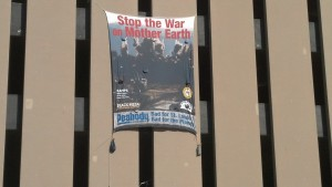 "Banner Reading ""Stop the War on Mother Earth.  Peabody: Bad for St. Louis, Bad for the Earth"